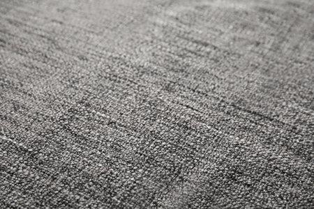 Soft warm gray plaid as background, closeup