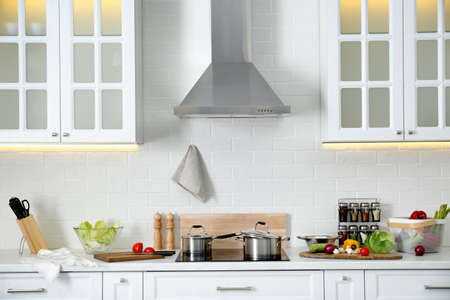 Modern kitchen interior with stylish white furniture Foto de archivo