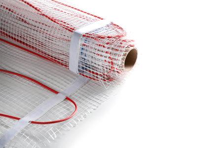 Installation of modern underfloor trace heating system indoors