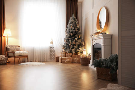 Beautiful living room interior with decorated Christmas tree and gifts