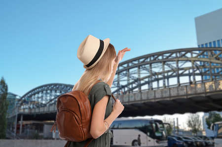 Traveler with backpack in foreign city during summer vacation