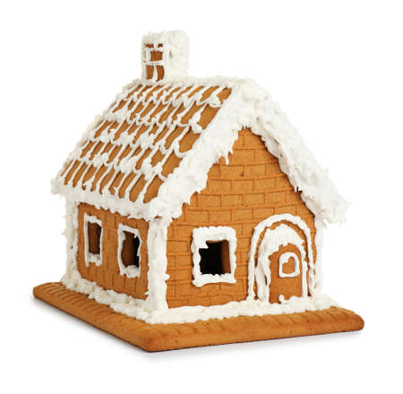 Beautiful gingerbread house decorated with icing on white background