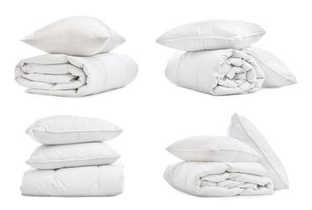 Set of blankets and pillows isolated on white Stock Photo