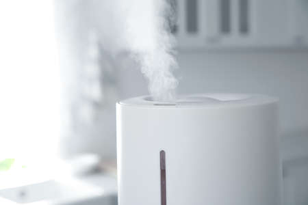 Modern air humidifier in kitchen, closeup view