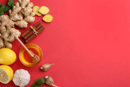 Flat lay composition with different natural antibiotics on red background, space for text Stock fotó