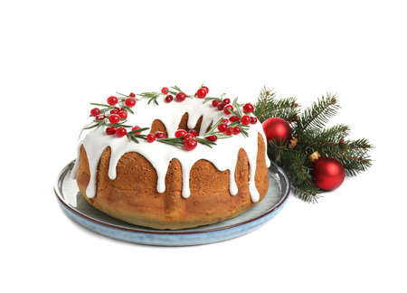 Traditional Christmas cake and decorations on white background