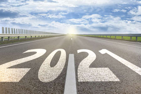 Start new year with fresh vision and ideas. 2021 numbers on asphalt road
