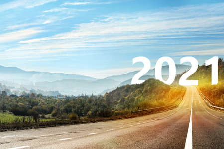 Start new year with fresh vision and ideas. Asphalt road leading to 2021 numbers