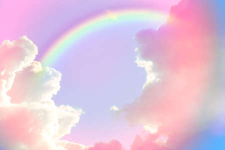 Amazing sky with rainbow and fluffy clouds, toned in unicorn colors