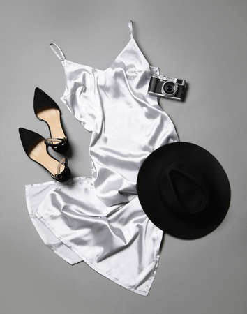 Flat lay composition with stylish white dress on gray background Archivio Fotografico