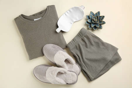 Flat lay composition with house slippers, sleeping mask and pajamas on light background Imagens