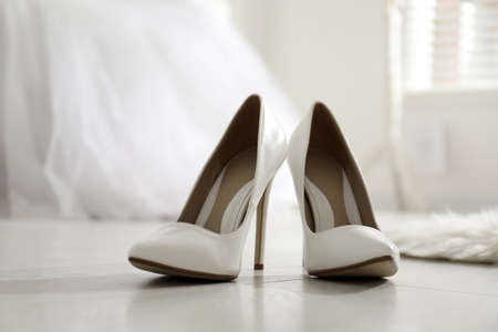 White wedding shoes on floor in room