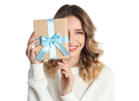 Beautiful young woman with Christmas present on white background