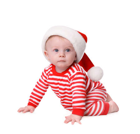 Cute baby in Santa hat and bright Christmas pajamas on white background Stock fotó