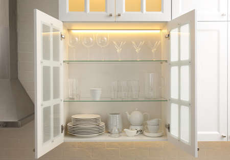 Cabinet with crockery and glassware. Order in kitchen