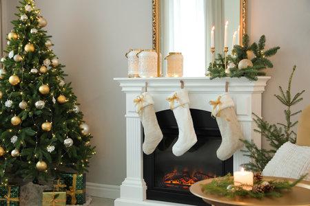 Beautiful living room interior with burning fireplace. Christmas celebration Stock Photo