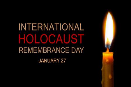 International Holocaust Remembrance Day January 27. Burning candle on black background