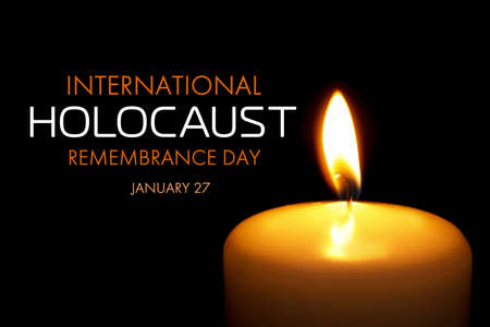 International Holocaust Remembrance Day January 27. Burning candle on black background, closeup