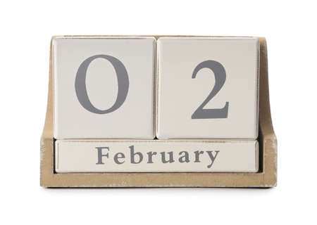 Wooden block calendar with date February 2nd on white background. Groundhog day