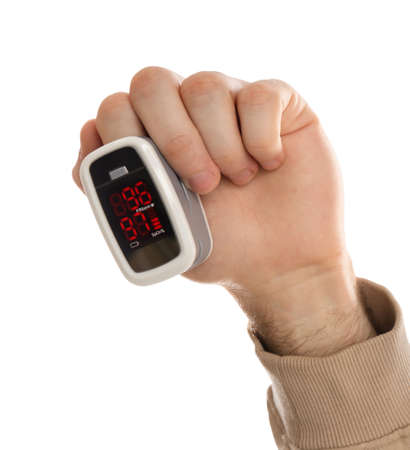 Man using pulse oximeter for oxygen level testing on white background, closeup