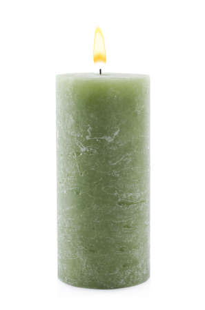 Burning green wax candle isolated on white Banco de Imagens