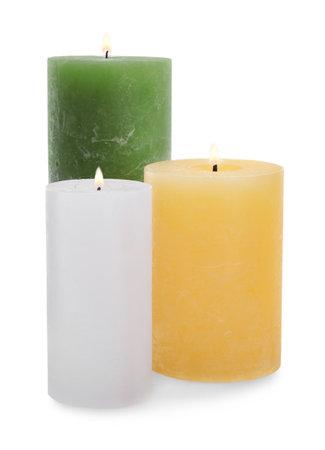 Set of burning wax candles on white background