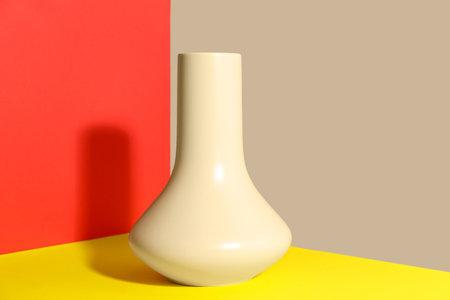 Stylish empty ceramic vase on color background Banco de Imagens