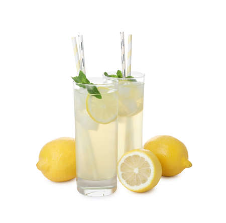Natural lemonade with mint and fresh fruits on white background. Summer refreshing drink Banque d'images