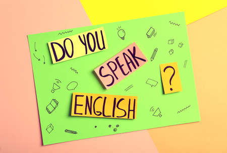 Note with question Do You Speak English on color background, top view
