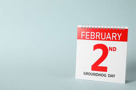 Calendar with date February 2nd on light background, space for text. Groundhog day