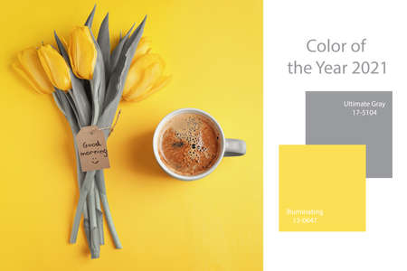 Color of the year 2021. Aromatic coffee, beautiful tulips and GOOD MORNING wish on yellow background, flat lay Zdjęcie Seryjne