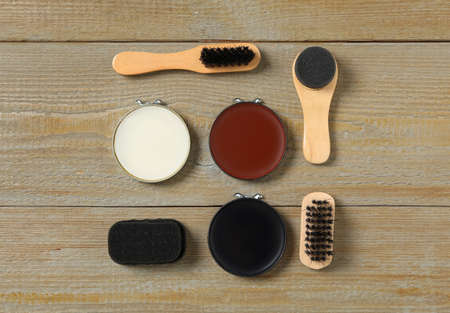 Flat lay composition with shoe care accessories on wooden background Stock Photo