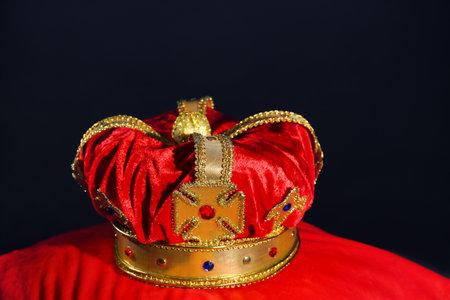 Beautiful velvet crown on red pillow. Fantasy item