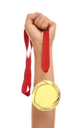 Woman holding gold medal on white background, closeup