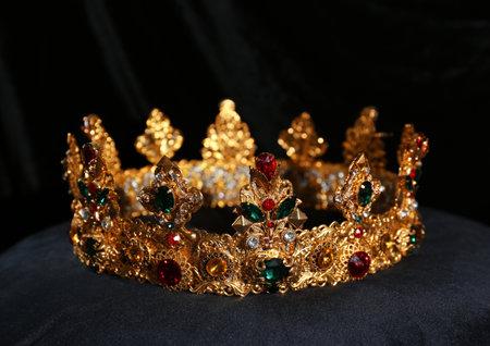 Beautiful golden crown on black velvet pillow. Fantasy item