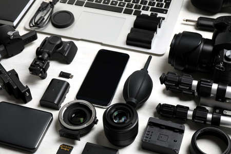 Camera equipment and accessories for video production on light background