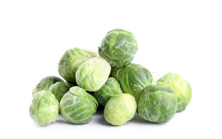 Pile of fresh Brussels sprouts isolated on white