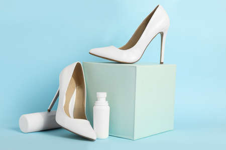 Composition with stylish footwear and shoe care accessories on light blue background Stock Photo