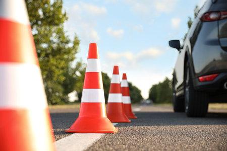 Traffic cones near car outdoors. Driving school exam 스톡 콘텐츠