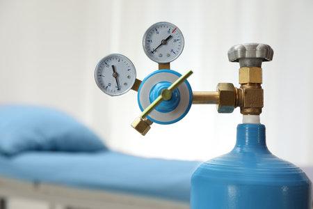 Medical oxygen tank in hospital room, closeup