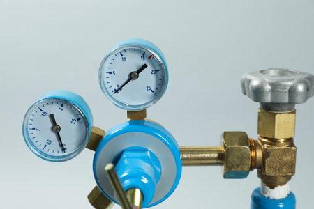 Pressure gauge of medical oxygen tank on light grey background, closeup Reklamní fotografie