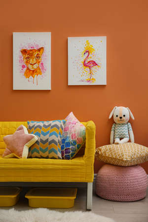 Cute pictures and comfortable sofa  in baby room interior Stock Photo