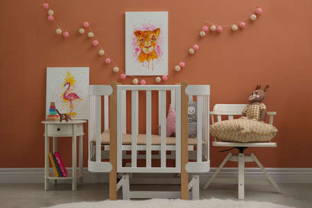 Cute pictures and crib in baby room interior