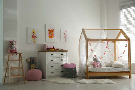 Cute pictures and and stylish furniture in baby room interior Stock Photo