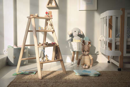 Beautiful baby room interior with stylish wooden ladder