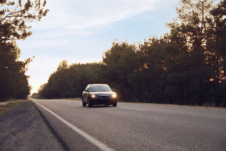 Beautiful view of asphalt highway with car. Road trip 스톡 콘텐츠