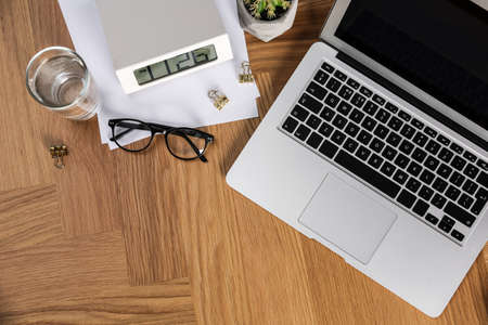 Flat lay composition with laptop and stationery on office table