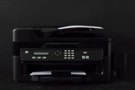 Modern printer with paper on black background Stock Photo