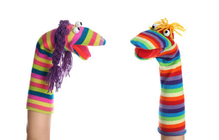 Funny sock puppets for show on hands against white background Banco de Imagens