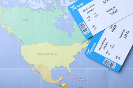 Tickets on world map, flat lay. Travel agency concept